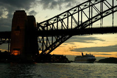 Under harbour bridge. Harbour Bridge evening silhouette, big ship in background Royalty Free Stock Photography