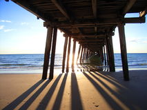 Under the Henley Jetty 2. Photo taken of the sun setting from underneath the jetty at Henley Square (Adelaide, Australia royalty free stock photos