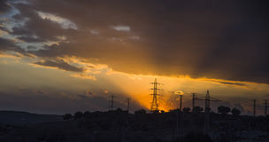 Under the high-voltage tower in the background. Sunset under the high-voltage tower in the background Stock Photo