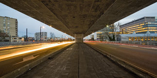 Under the highway. Long shuttertimes under a highway bridge Royalty Free Stock Photography