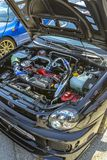 Under the hood of a car on exhibit with hard shadows Royalty Free Stock Photo