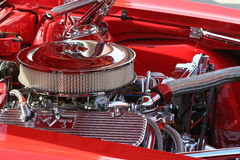 Under the Hood. Lots of shiny Chrome and red paint under the hood of this Classic Car Royalty Free Stock Photos
