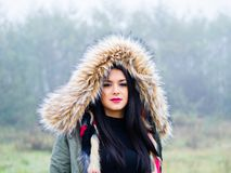 Under hood teen girl. Under hood cold weather teenager girl outdoors foggy day forest isolated Royalty Free Stock Photo