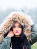 Under hood teen girl portrait. Under hood cold weather portrait cute teen girl outdoors foggy day forest isolated warm clothing Royalty Free Stock Photography
