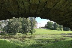 Under the humpbacked bridge. Pavlovsky Park. The city of Pavlovsk. Pavlovsky Park - a landscape park as part of the Pavlovsk State Museum-Reserve. Located in royalty free stock images