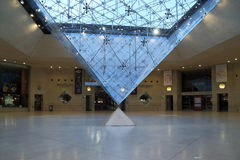 Under the inverted pyramid. PARIS, FRANCE MAY 13, 2015: The inverted pyramid under the Carousel area is included in the architectural composition of the five stock image