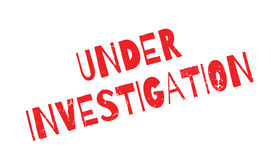 Under Investigation rubber stamp Stock Photo