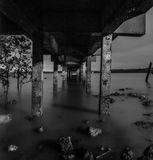 Under jetty black and white. This artistic image taken during sunset and transform to black and white stock photos