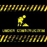 Under konstruktion - grungeillustration med symbolen som är passande för websites Arkivbild