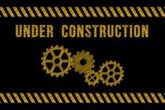 Under konstruktionsvägmärke i guling på svart med band royaltyfri illustrationer