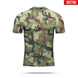 Under layer compression shirt in camouflage style. Base layer underwear compression t-shirt of thermal fabric  in woodland camouflage style. Sample typical Stock Photos