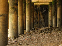 Under London Wharves. Piers under City of London wharf at low tide Stock Image