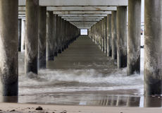 Under a long pier Stock Image