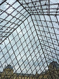 Under the Louvre Pyramid. View from standing under Louvre Pyramid in Paris, France Stock Images