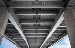 Under modern metal bridge Stock Photo