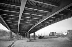Under modern metal bridge. Urban view: small old bridges under modern automotive metal bridge Royalty Free Stock Image