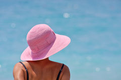 Under my hat. Beautiful woman enjoying the sun Royalty Free Stock Images