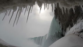 Under Niagara Falls in Winter. View from Under the Falls of Horseshoe falls coated in ice with sound stock footage