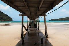 under old and break sea wood bridge pier  to harbor in Koh Kood Stock Photography
