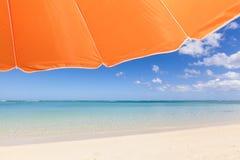 Under an orange sunshade Stock Photo