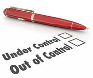 Under or Out of Control Pen Check Boxes Managing Project Well or Royalty Free Stock Image