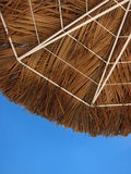 Under a Palapa's Shade. Bottom-up view of a palapa in Aruba, in the Caribbean Stock Image