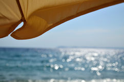 Under parasol Royalty Free Stock Photos