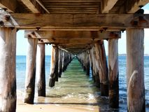 Under the Pier. Like a sea corridor over the water to the horizon at Point Lonsdale, Victoria, Australia Royalty Free Stock Photo