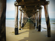 Under the pier. On a bright sunny day Royalty Free Stock Image
