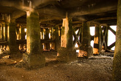 Under the Pier. Another mysterious place, under a pier in Portugal Royalty Free Stock Image