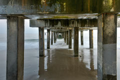 Under the Pier at the Beach Royalty Free Stock Photography