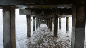 Under the Pier at the Beach. At Coney Island, Brooklyn, New York stock footage