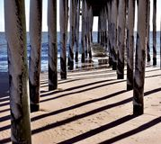 Under a pier on a cold winter day royalty free stock photos