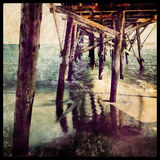 Under the Pier, Malibu Beach, California. Grungy distressed photo art of the pier at Malibu Beach, California Royalty Free Stock Photo