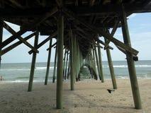 Under Pier By The Sea royaltyfri fotografi
