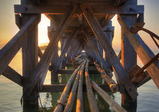 Under a Pier at Sunset Stock Photography