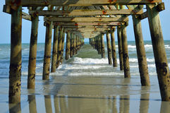 Under Pier. A view from under Cherry Grove Beach Pier in North Myrtle Beach, SC royalty free stock photo