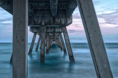 Under the pier. View of the ocean from under a boardwalk pier in Delray Beach, Florida stock photography