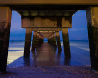 Under the Pier. Was created under the fishing pier at Woodland Beach Delaware at twilight Royalty Free Stock Photography