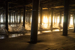 Under the Pier. Waves crashing under the pier Stock Images