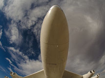 Under a Plane. Underneath a large flying plane Royalty Free Stock Photography