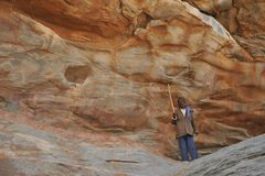 Under police guard. LAS GIL, SOMALIA - JANUARY 9, 2010:Complex of caves Las Gil with petroglyphs one of the monuments of ancient culture in Africa, its Royalty Free Stock Photography