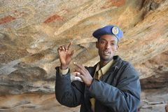 Under police guard. LAS GIL, SOMALIA - JANUARY 9, 2010: Complex of caves with petroglyphs is the most significant monument of the epoch of the neolith in Africa Royalty Free Stock Photos