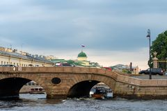 Under the Prachechny Bridge. RUSSIA, SAINT PETERSBURG - AUGUST 18, 2017: Pleasure boat comes from the river Neva under the Prachechny Bridge Stock Photos