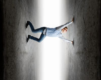 Under pressure. Young troubled businessman trapped between two walls Stock Image