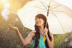 Under the rain. Portrait of beautiful young teen girl with umbrella under rain Stock Image