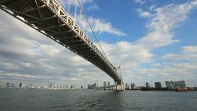 Under rainbow bridge at tokyo bay. Zoom shot stock footage