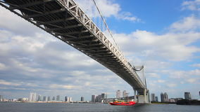 Under rainbow bridge at tokyo bay zoom shot stock footage
