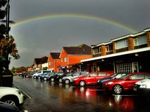 I can see a rainbow. Rainbow over town Royalty Free Stock Photo
