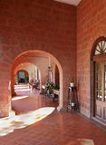Under the red brick arches art deco patio Royalty Free Stock Photos